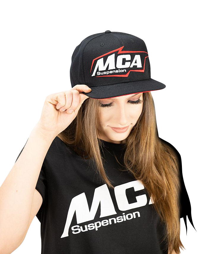 A photo of a girl showing off the 2020 version of the MCA Suspension hat.